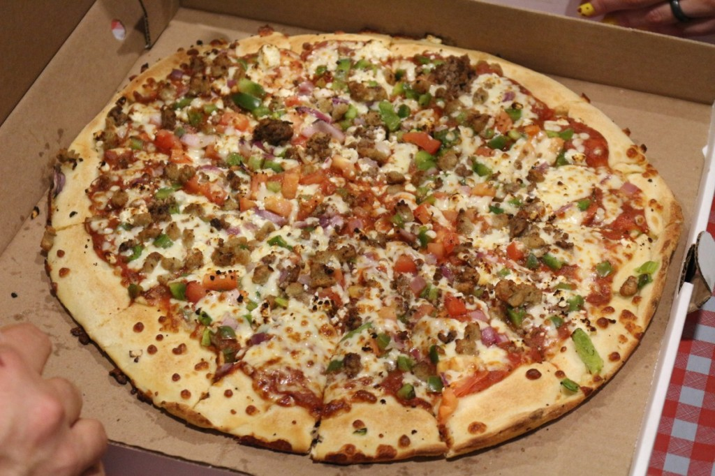 Freeman's House Specialty: Italian sausage, ground beef, feta cheese, tomato, green pepper, red onion